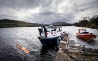 In this picture taken April 13, 2016, engineer John Haig helps launch the Munin AUV (Autonomous Underwater Vehicle) at Loch Ness. An underwater robot exploring Loch Ness has discovered a dark, monster-shaped mass in its depths. Disappointingly, tourism officials say the 30-foot (9 meter), object is not the fabled Loch Ness Monster, but a prop left over from a 1970 film. (Danny Lawson/PA via AP) UNITED KINGDOM OUT