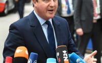 British Prime Minister David Cameron speaks with the media as he arrives for an EU summit in Brussels on Tuesday, June 28, 2016. EU heads of state and government meet Tuesday and Wednesday in Brussels for the first time since Britain voted to leave the European Union, throwing British and European politics into disarray. (AP Photo/Geert Vanden Wijngaert)