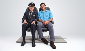 Mike Swanigan with Russell Wilson in an Alaska Airlines ad. (Alaska Airlines)