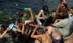 People cool themselves in a stream to beat the heat as temperatures reached 38 Celsius (100F) during the Muslim holy fasting month of Ramadan, Monday, May 29, 2017, in Islamabad, Pakistan. (AP Photo/B.K. Bangash)