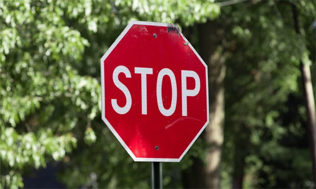 Stop sign, cyclists...