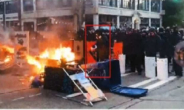 Jacob Greenberg, 19, is accused of assault and arson, captured in this photo squirting a flammable ...