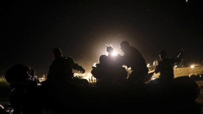 United States agents rescue a migrant child from the waters of the Rio Grande after her parents los...
