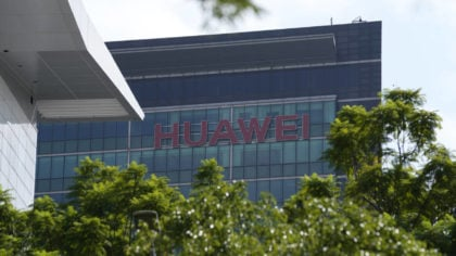 The company logo of Huawei is seen on a building in the sprawling Huawei headquarters campus in She...