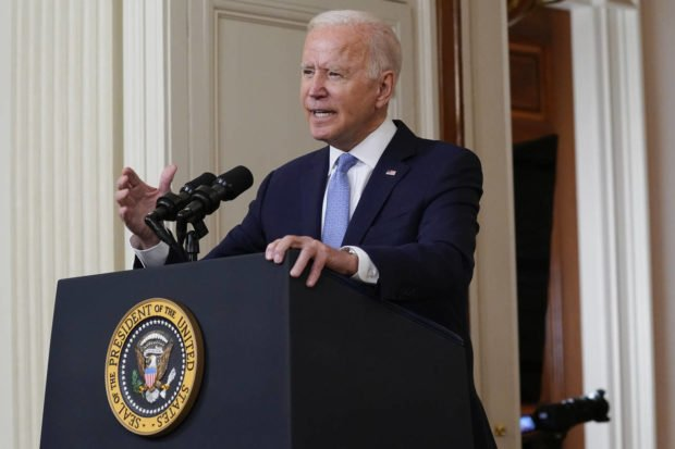 President Joe Biden speaks about the end of the war in Afghanistan from the State Dining Room of the White House