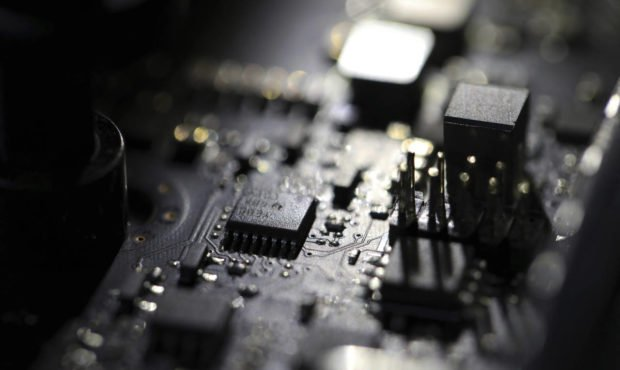 FILE - This Feb 23, 2019, file photo shows the inside of a computer. Three former U.S. intelligence...