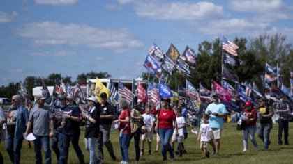 Supporters file into the Georgia National Fairgrounds in Perry, Ga., to attend former president Don...