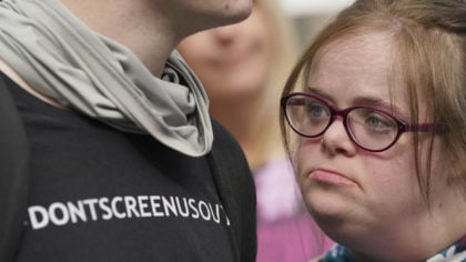 Campaigner Heidi Crowter looks on after speaking to the media after her court case, outside the Hig...