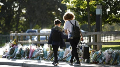 A mother and son walk past floral tributes for murdered 28-year-old teacher Sabina Nessa in Kidbroo...