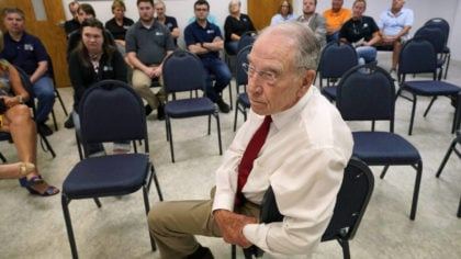 In this June 30, 2021, photo Sen. Chuck Grassley, R-Iowa, listens to a question during a meeting wi...