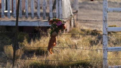 A bouquet of flowers is left to honor cinematographer Halyna Hutchins outside the Bonanza Creek Ran...