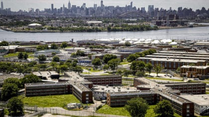 FILE - This Tuesday Dec. 2, 2014, file photo shows the Rikers Island jail complex in the foreground...