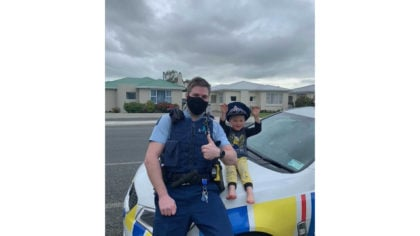 In this photo released by New Zealand Police, an officer identified only as Constable Kurt sits on ...